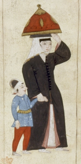 Woman and boy going to the hammam